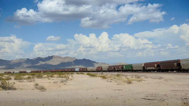 Mojave landscape with train and cloudy sky